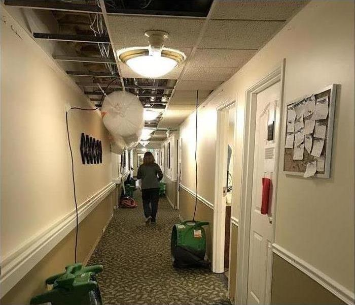 Hallway with water damage.