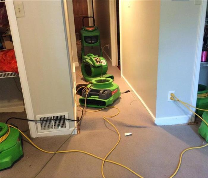 Green SERVPRO equipment in the hallway of a West Valley City home.